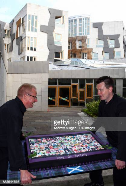 Chef Paul Bradford with a birthday cake being delivered to the Scottish Paliament to celebrate its 10th anniversary The cake is decorated with the...