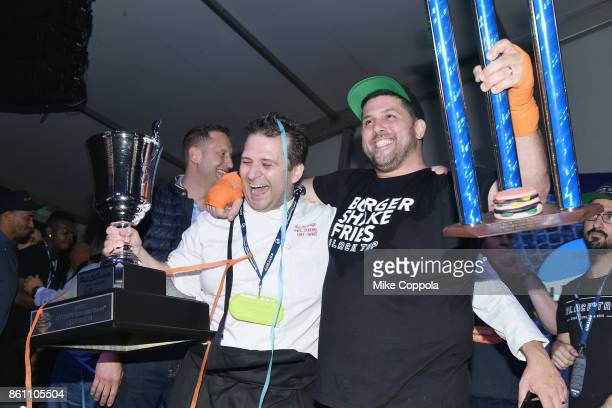 Chef Paul Denamiel of Le Rivage and chef Joe Isidori Black Tap Burger pose with their trophies at the Food Network Cooking Channel New York City Wine...