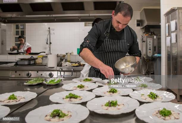 Chef Paulo Cardoso prepares octopus carpaccio for participants at five stars hotel Parador Casa da Insua during Gastronomic FAM Tour on November 28...