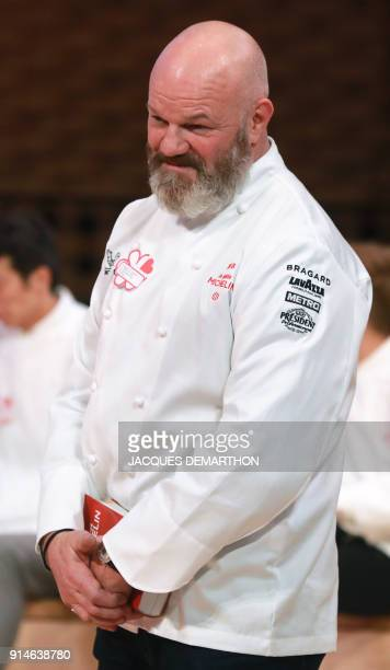 Chef Philippe Etchebest reacts after being awarded his first star for his restaurant 'Le Quatrième Mur' during the Michelin guide award ceremony at...