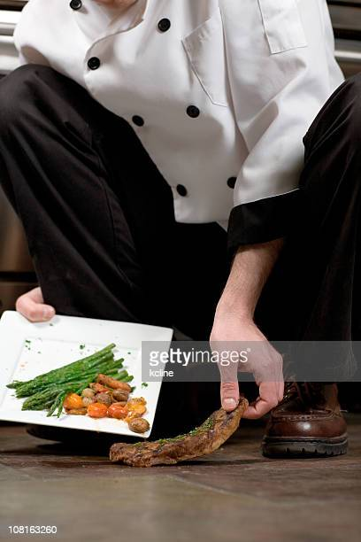 Chef Picking Steak Off Floor
