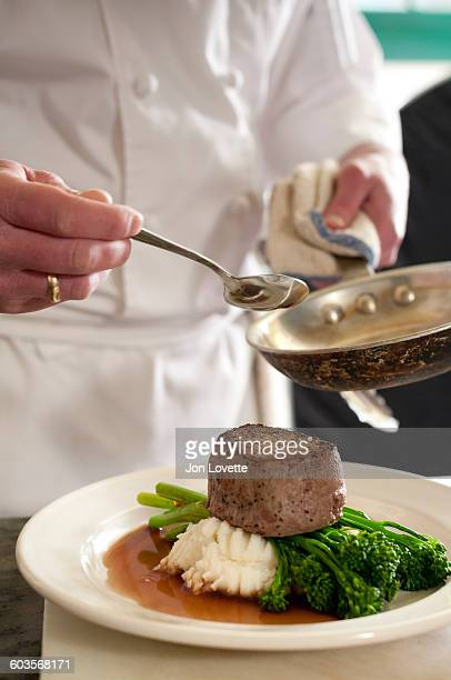 Chef plating steak