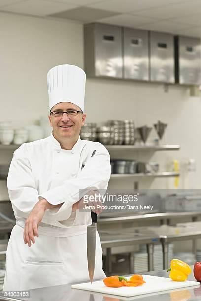 Chef posing in kitchen