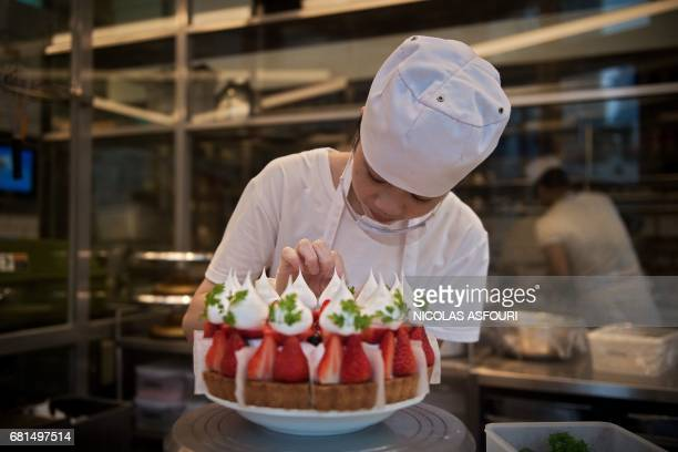 A chef prepares a cake at restaurant in Shenzhen on May 10 2017 Chinese exports rose for the second consecutive month in April official data showed...
