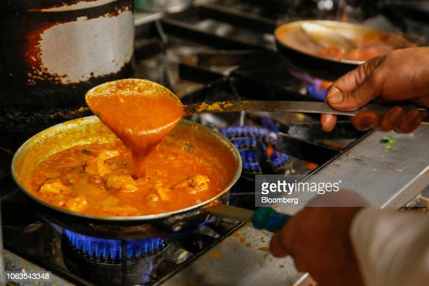 A chef prepares a curry dish in the kitchen of the Indo Indian fine dining restaurant in Chobham UK on Wednesday Nov 14 2018 Almost two decades...