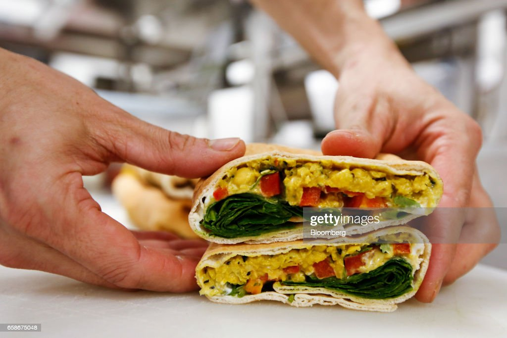 A chef prepares a sandwich wrap in the kitchen of a branch of food retailer Pret a Manger Ltd. in London, U.K., on Monday, March 27, 2017. Food chain Pret a Manger said it's concerned about Brexit because just one in 50 applicants seeking jobs is British. Photographer: Luke MacGregor/Bloomberg via Getty Images