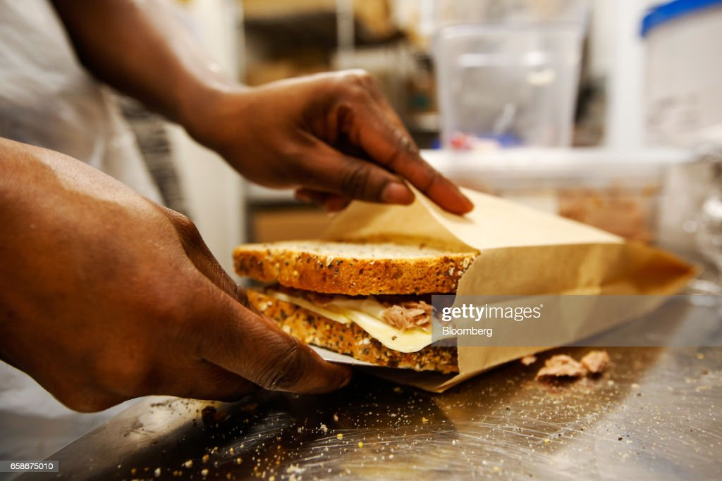 A chef prepares a toasted sandwich in the kitchen of a branch of food retailer Pret a Manger Ltd. in London, U.K., on Monday, March 27, 2017. Food chain Pret a Manger said it's concerned about Brexit because just one in 50 applicants seeking jobs is British. Photographer: Luke MacGregor/Bloomberg via Getty Images