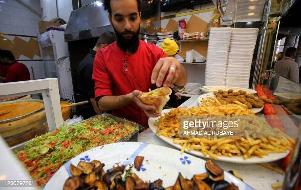 Chef prepares an order at the Sadriya market in the centre of Iraq's capital Baghdad on January 26 as the Baghdad Municipality re-opens the area...