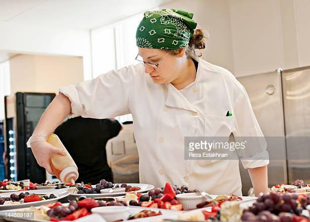 chef prepares appetizers - バンダナ ストックフォトと画像