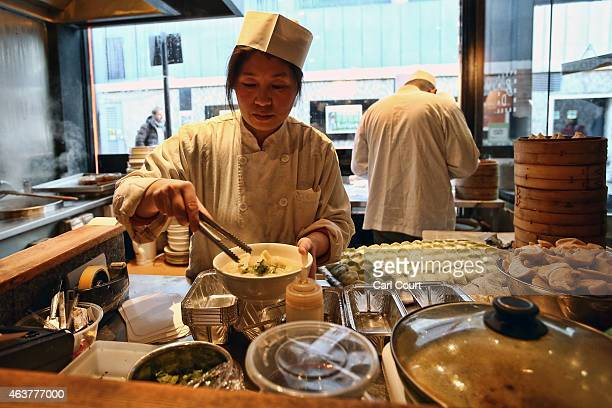 Chef prepares dumplings in a restaurant in China Town on February 18, 2015 in London, England. Chinese New Year 2015 , the Year of the Sheep, will be...