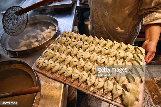A chef prepares dumplings in a restaurant in China Town on February 18 2015 in London England Chinese New Year 2015 the Year of the Sheep will be...