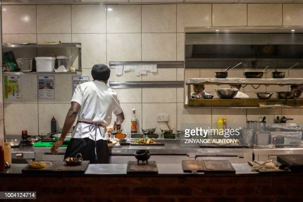 A chef prepares food at a restaurant on June 28 2108 in the resort town of Victoria Falls After nearly two decades in the doldrums Zimbabwe's tourism...
