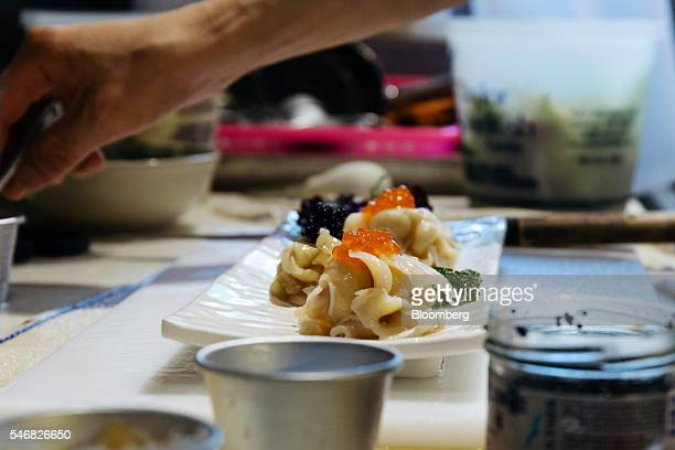 A chef prepares geoduck sashimi at the Taylor Shellfish Farms restaurant in the Sai Ying Pun area of Hong Kong China on Friday June 17 2016 Geoducks...