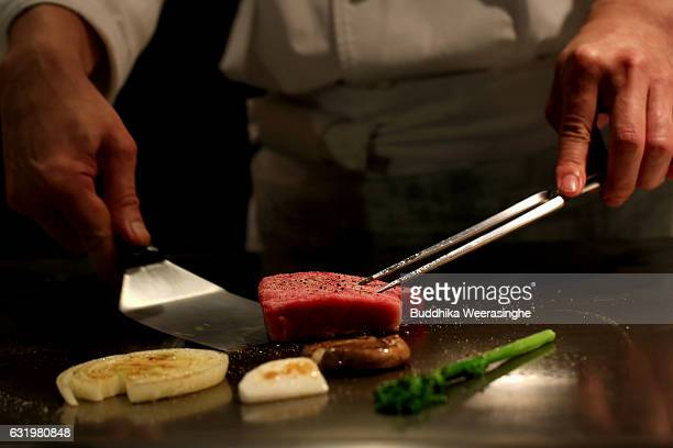 A chef prepares Kobe beef steaks in a Kobe Plaisir restaurant on January 18 2017 in Kobe Japan Kobe city is home to renowned Japanese wagyu beef...