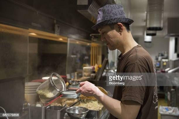 A chef prepares ramen inside at an Ippudo restaurant operated by Chikaranomoto Holdings Co in Tokyo Japan on Tuesday May 9 2017 In addition to the...