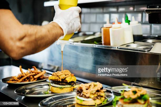 chef preparing artisan burgers - food state stock pictures, royalty-free photos & images