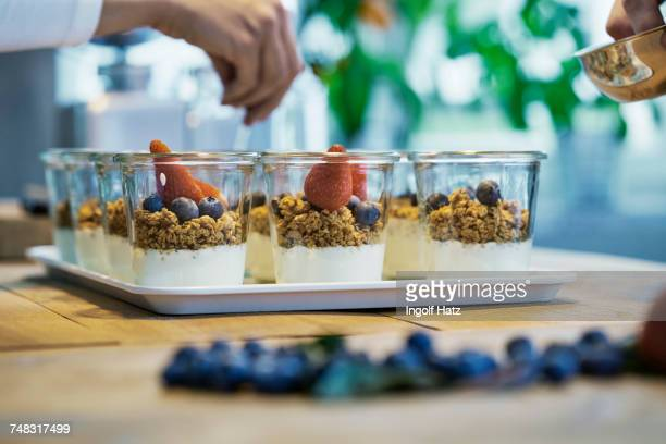 Chef preparing berry desserts, close-up