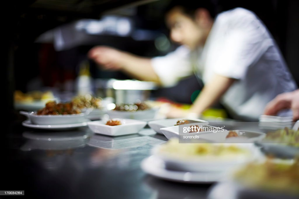 Chef preparing dishes : Stock Photo