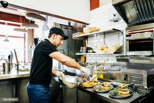 Chef Preparing Food For Customers