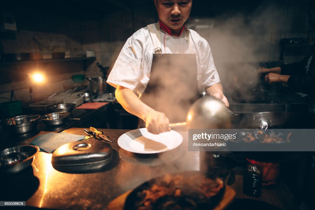 Chef preparing food in Chinese restaurant : Stock Photo