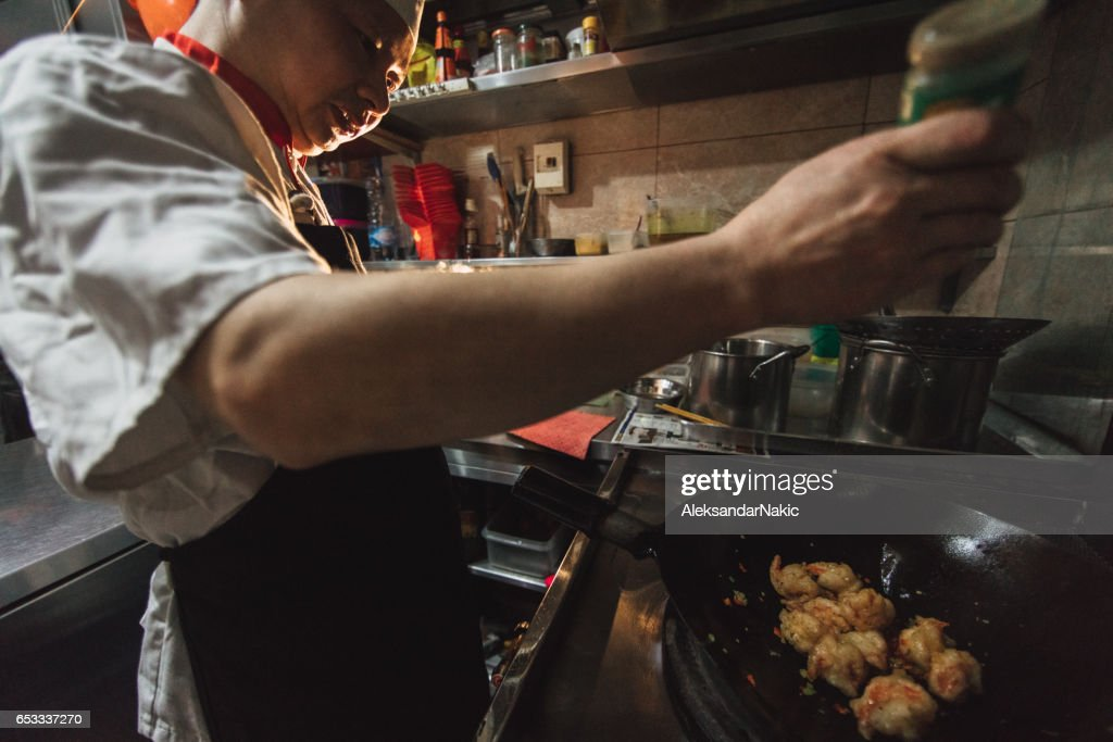 Chef preparing food in Chinese restaurant : Stock Photo