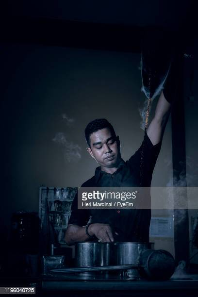 chef preparing food in kitchen - heri mardinal stock pictures, royalty-free photos & images