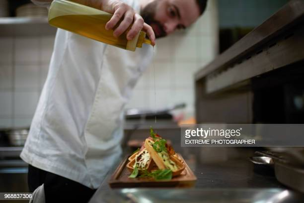 chef preparing food - garnish stock pictures, royalty-free photos & images