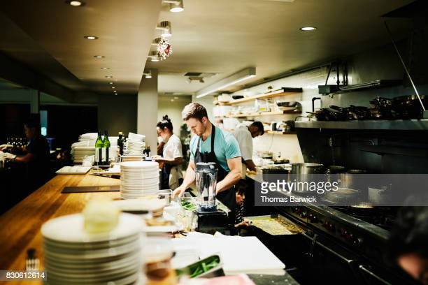 Chef preparing for dinner service in restaurant kitchen
