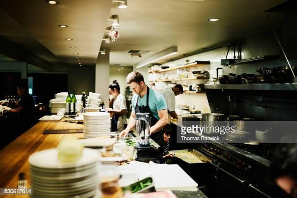 Chef preparing for dinner service in restaurant kitchen