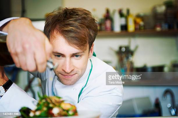 chef preparing meal in restaurant