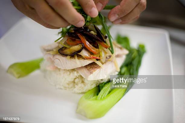Chef preparing red snapper with bok choy