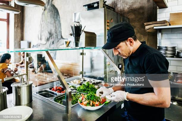 chef preparing salad dish for customer - canteen stock pictures, royalty-free photos & images
