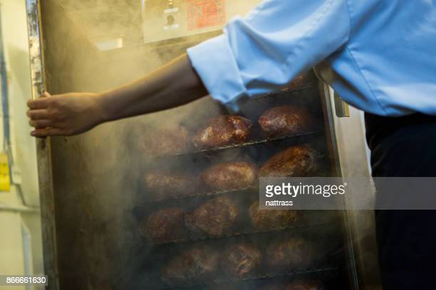 chef preparing smoked meat - smoked food stock photos and pictures