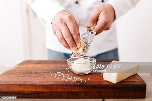 chef preparing stuffing for ravioli, grating parmesan cheese - parmesan cheese stock pictures, royalty-free photos & images