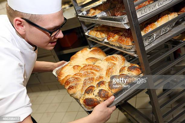 A chef puts freshly baked challah on a rack during the Mega Challah Bake at the local Chabad community's Kosher Festival on March 15 2015 in Berlin...