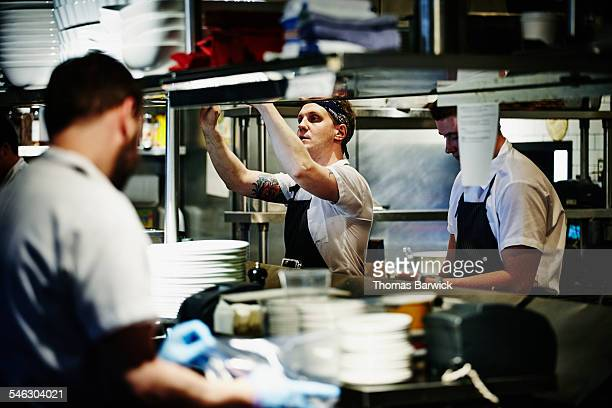 Chef reviewing order in restaurant kitchen