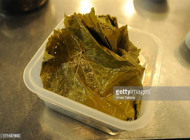 Chef Reza Parsia for Feast dolmades recipe which invoves grape leaves Metaxa soaked golden raisins pine nuts dill parsleymint Arborio rice tzatkiki...
