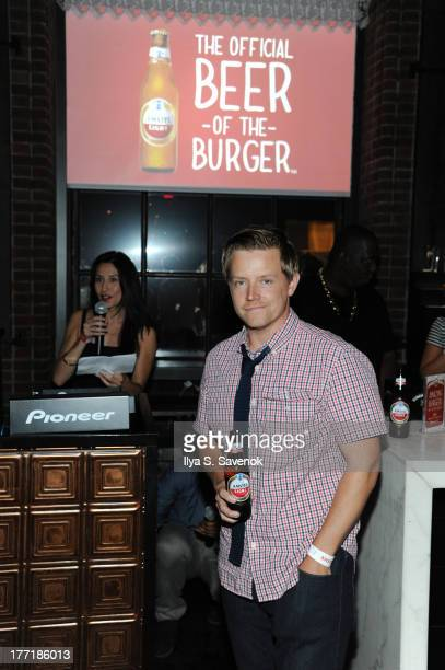 Chef Richard Blais enjoys an 'Official Beer of the Burger' at Time Out New York's Battle of the Burger presented by Amstel Light