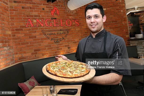 TORONTO ON OCTOBER 6 Chef Rick Ruggiero holds a 'Goodfella' pizza at Angelo's Coal Fired Pizza October 6 2016 For Now Open column