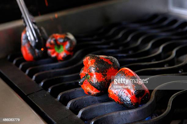A chef roasts bell peppers inside the PepsiCo Inc FritoLay Flavor Kitchen at the company's headquarters in Plano Texas US on Wednesday April 16 2014...