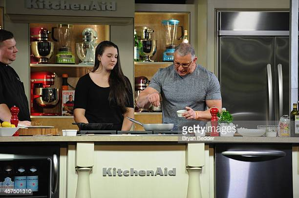 Chef Robert Irvine conducts a culinary presentation with his daughter Annalise Irvine at KitchenAid stage at the Grand Tasting presented by ShopRite...