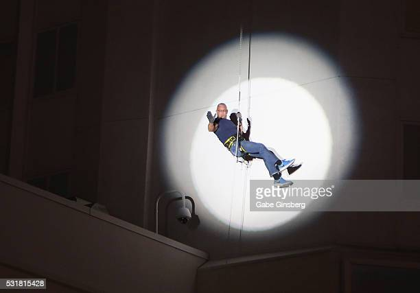 Chef Robert Irvine rappels down the side of the Tropicana Las Vegas to announce his new restaurant concept at the Tropicana Las Vegas on May 16 2016...
