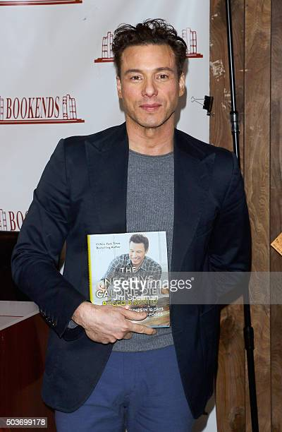 """Chef Rocco DiSpirito signs copies of his new book """"The Negative Calorie Diet"""" at Bookends Bookstore on January 6, 2016 in Ridgewood, New Jersey."""