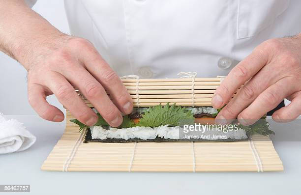 Chef rolling sushi