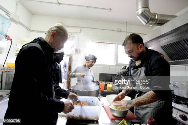 Chef Rubio and the writer Erri De Luca cook at the presentation of Meal Suspended at Casetta Rossa in Garbatellaon February 2 2017 in Rome Italy The...