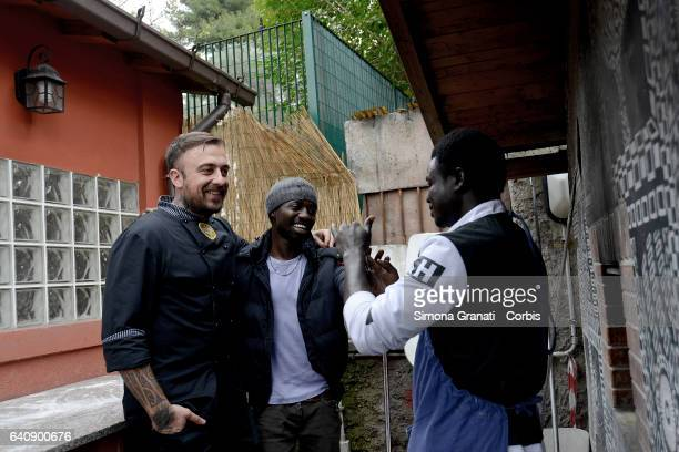 Chef Rubio cooking with migrant at the presentation of Meal Suspended at Casetta Rossa in Garbatellaon February 2 2017 in Rome Italy The initiative...