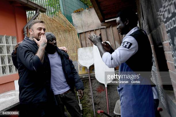 Chef Rubio with migrant at the presentation of Meal Suspended at Casetta Rossa in Garbatellaon February 2 2017 in Rome Italy The initiative promotes...