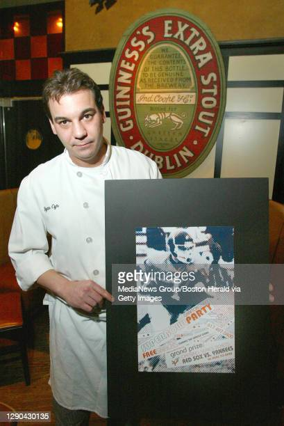 Chef Ryan Cyr of Grafton Street in Cambridge holds up a poster Tuesday night advertising the restaurant's Superbowl party on Sunday. PHOTOG NOTE:...