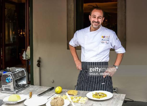 "Chef Samuel Perico, of the 'Trattoria Sant'Ambroeus' in Bergamo's upper city, poses as he prepares typical pasta dish ""I Casoncelli"" on June 16,..."