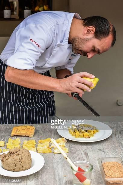 """Chef Samuel Perico, of the 'Trattoria Sant'Ambroeus' in Bergamo's upper city, prepares typical pasta dish """"I Casoncelli"""" on June 16, 2020. - Bergamo,..."""